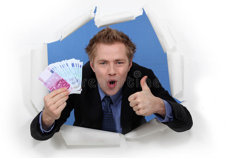 Download Businessman holding cash stock photo. Image of businessperson - 27811102