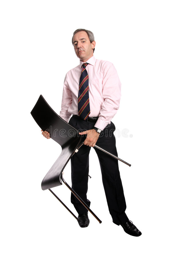 Businessman holding a chair stock image