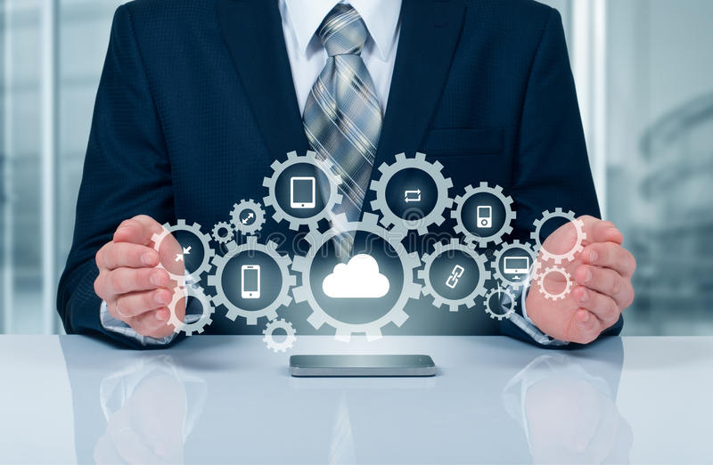 Businessman holding a cloud connected to many objects on virtual screen concept about the internet of things. Businessman holding a cloud connected to many royalty free stock photos
