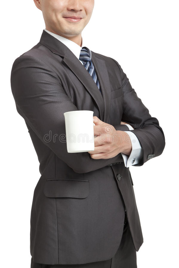 Businessman holding coffee cup