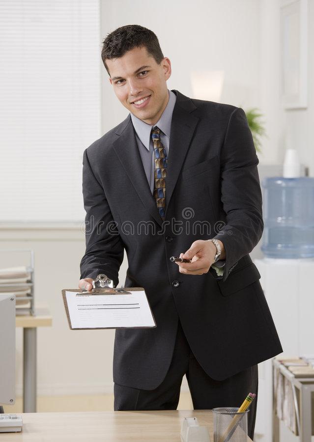Businessman Holding Contract And Pen Royalty Free Stock Photography