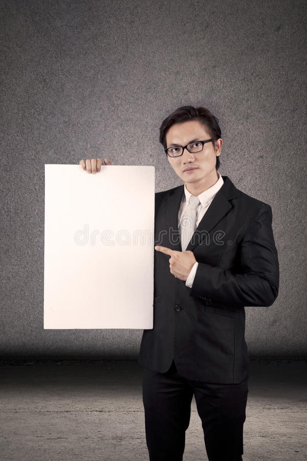 Businessman Holding A Copyspace Stock Photo
