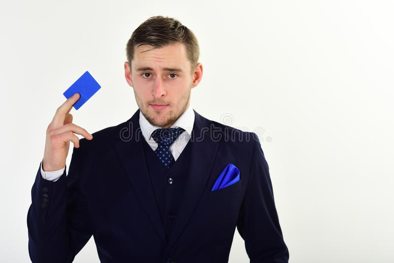 Businessman holding credit card. Man in formal suit holds plastic card and recommends to keep money on bank account royalty free stock image