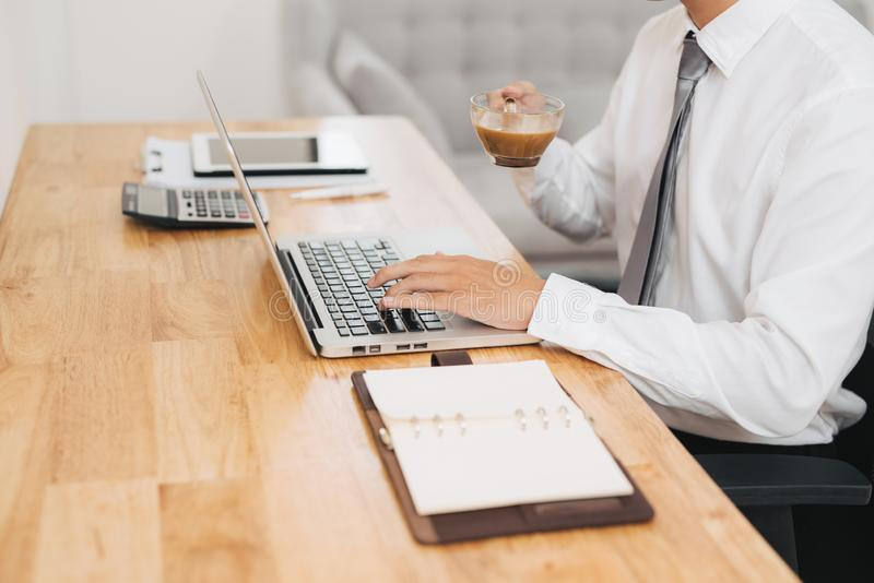 Businessman holding a cup of coffee in the break. Concept of office work and a rest break royalty free stock photo