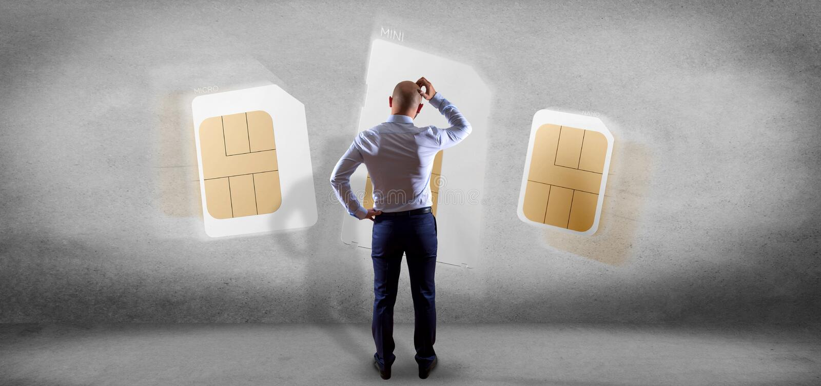 Businessman holding Different size of a smartphone sim card 3d rendering. View of a Businessman holding Different size of a smartphone sim card 3d rendering stock photo