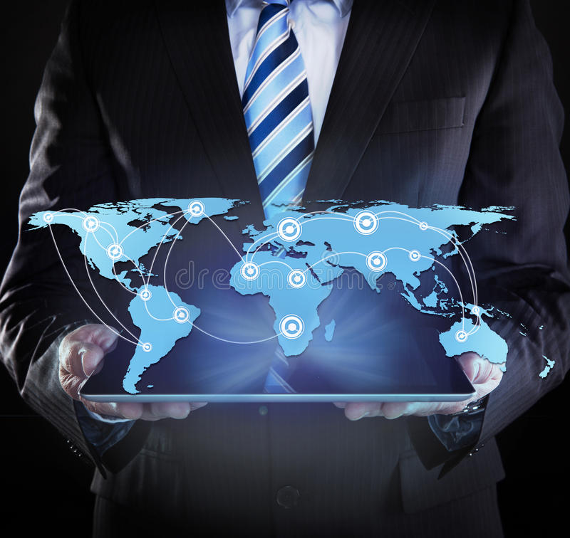 Businessman Holding Digital Tablet With Connected World Map. Midsection of businessman holding digital tablet with connected world map over black background stock images
