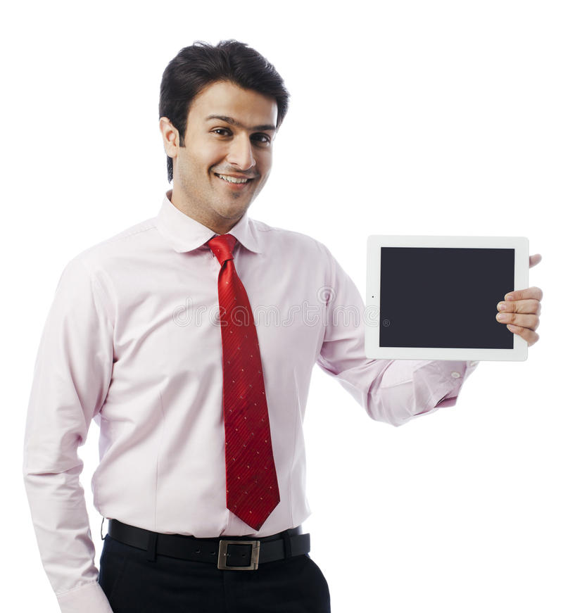 Businessman holding digital tablet and smiling stock photos