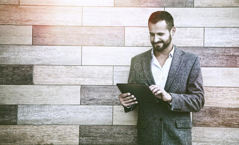 Businessman holding digital tablet touching with finger stock photos
