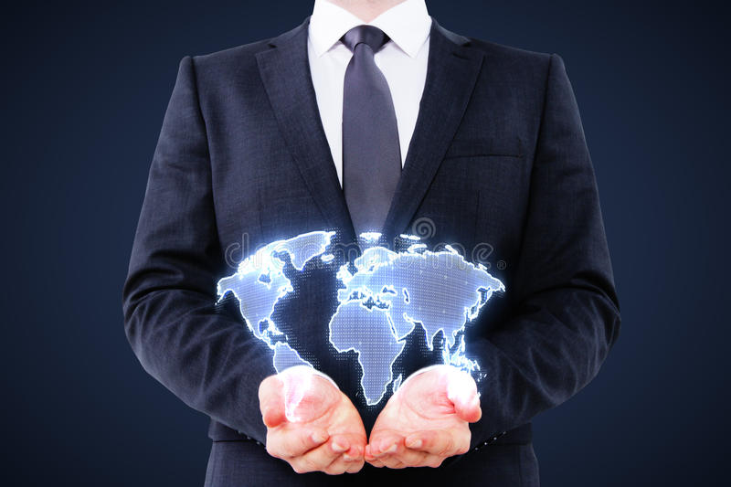 Businessman holding digital world map. Interface on blue background royalty free stock photography
