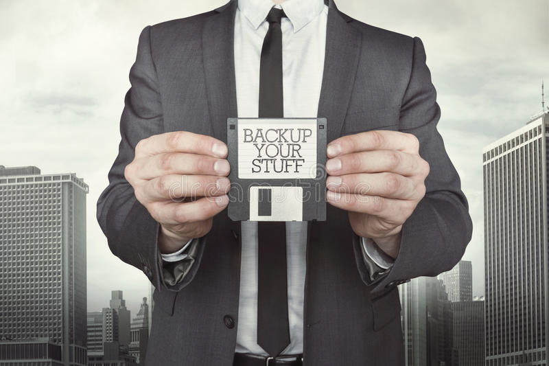 Businessman holding diskette in hands stock photo