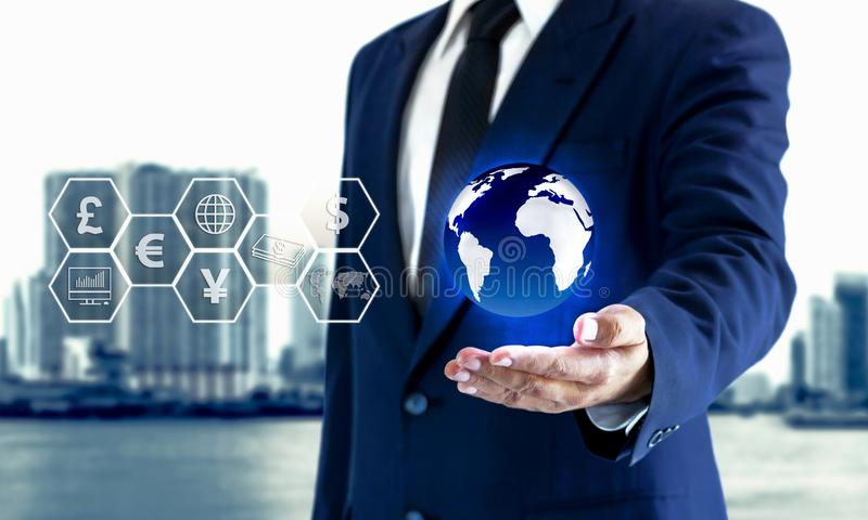 Businessman holding earth in the hand and a virtual icon royalty free stock photo