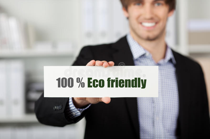 Businessman Holding Eco Friendly Sign stock photography