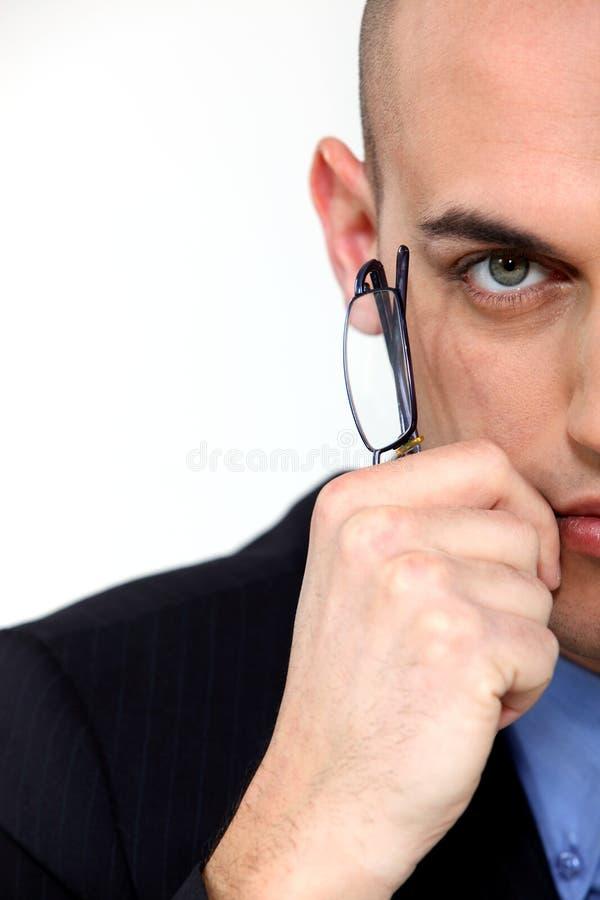 Businessman Holding Eyeglasses Stock Photos