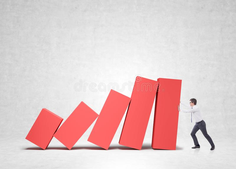 Businessman holding falling bar chart royalty free stock images