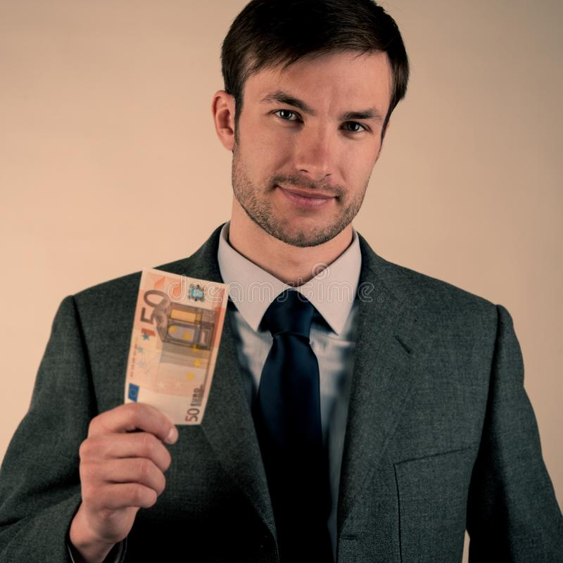 Businessman is holding fifty euros. stock images