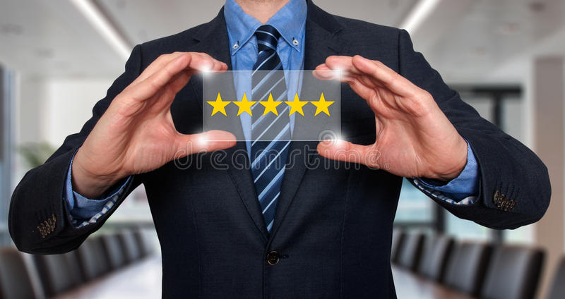 Businessman holding five star rating royalty free stock photos