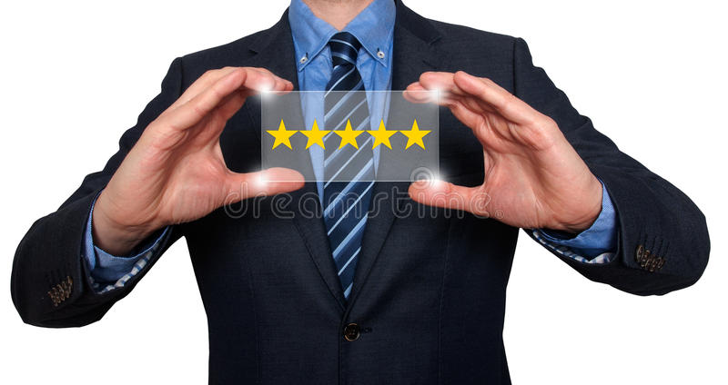 Businessman holding five star rating stock image