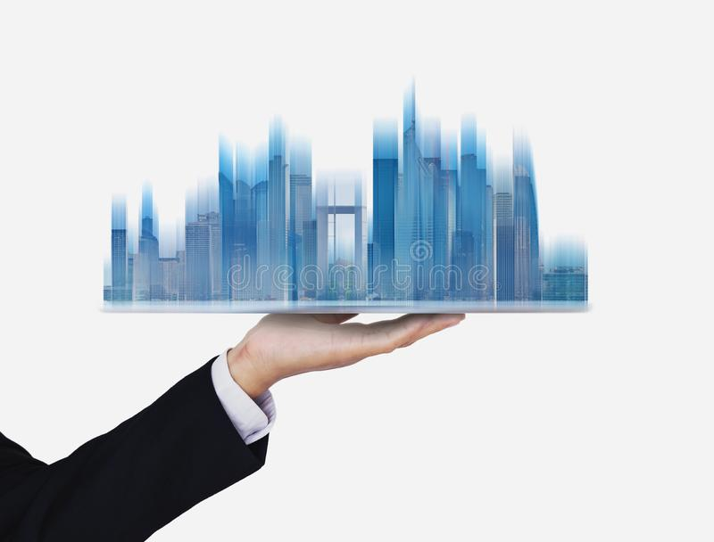 Businessman holding futuristic smart buildings hologram, on white background. S stock images