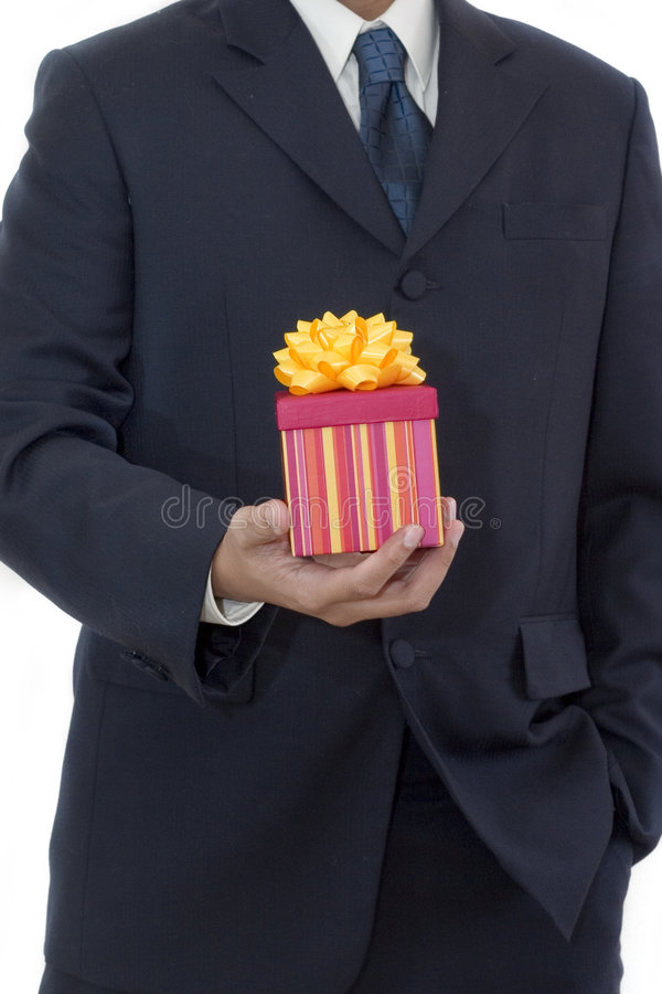 Businessman Holding a Gift. A gift for you stock photos