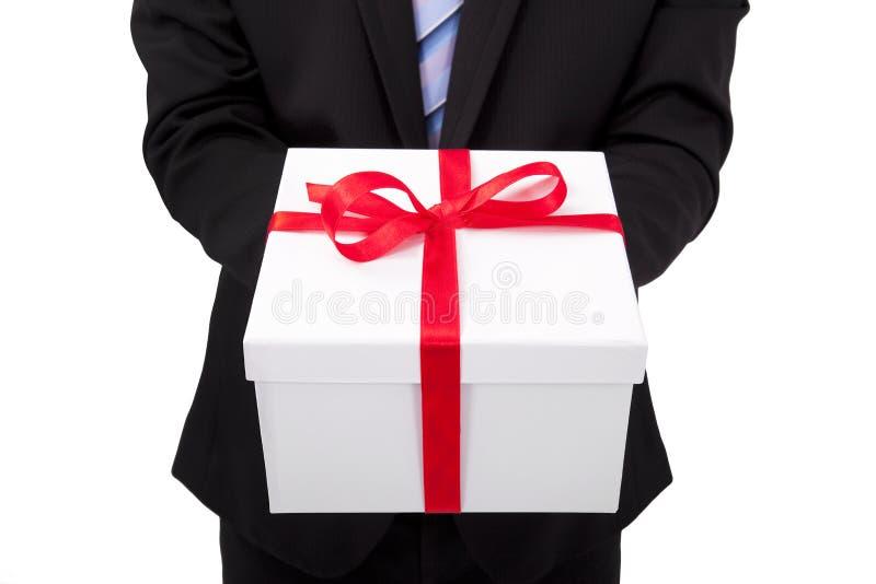 Businessman holding gift box stock image