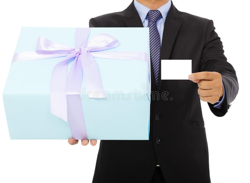 Businessman holding a gift box and a card. Isolated on white background royalty free stock photos