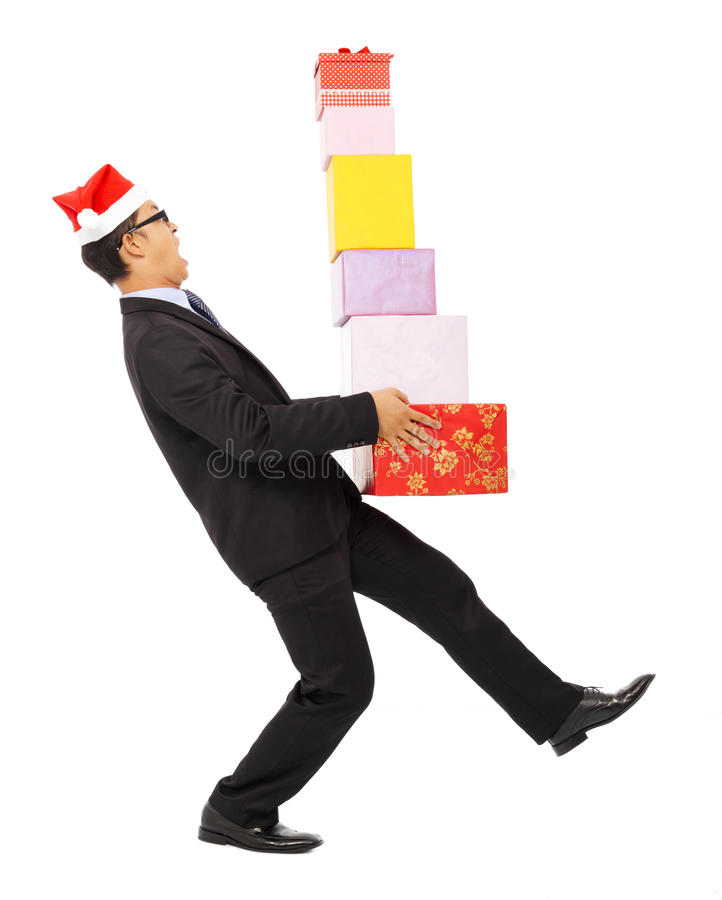 Businessman holding gift boxes and scared to fall. Isolated on white background stock photo