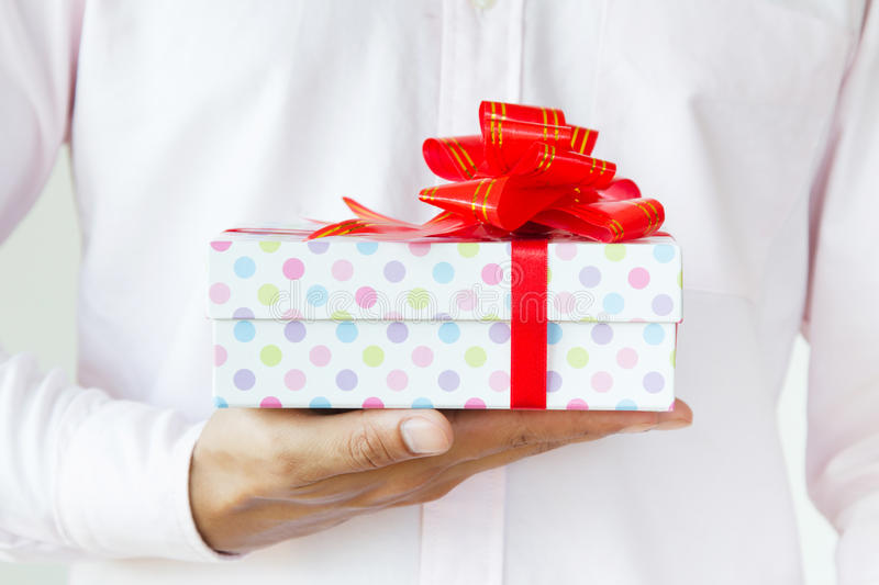 Businessman holding a gift royalty free stock images