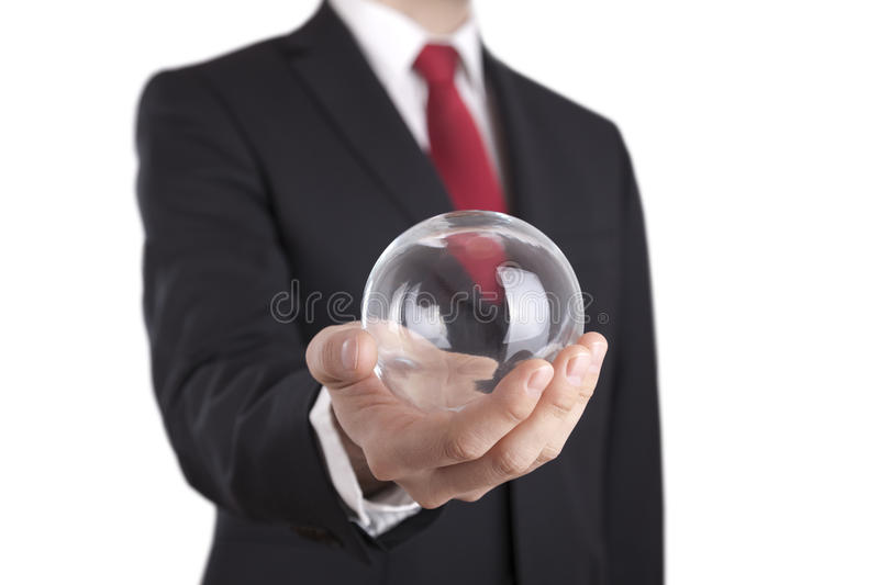 Businessman holding a glass ball isolated on white stock photography