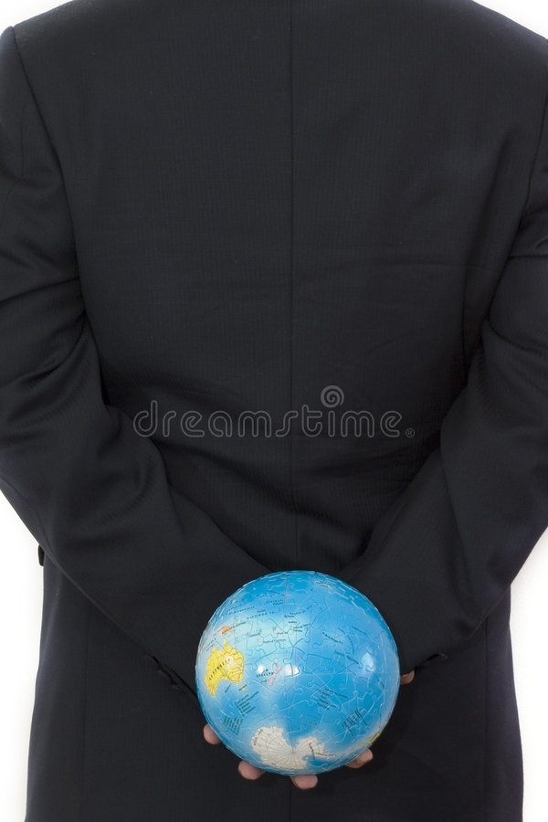Businessman holding a globe. Businessman with a Globe 3D Puzzle royalty free stock photo