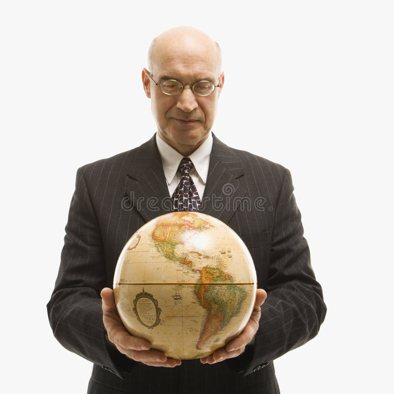 Businessman holding globe. royalty free stock image
