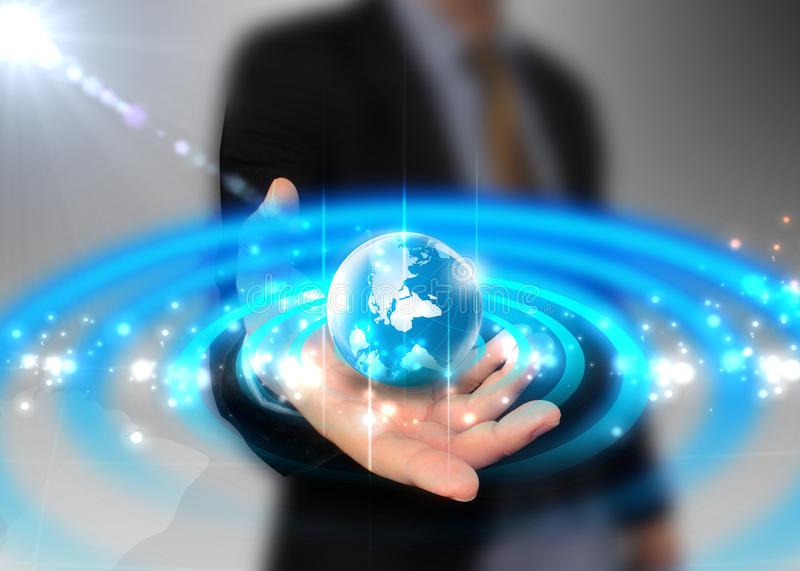 Businessman holding globe glowing. Technology concept royalty free stock photography