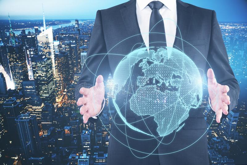 Global business concept. Businessman holding glowing planet on blue background. Global business concept. Double exposure stock photo