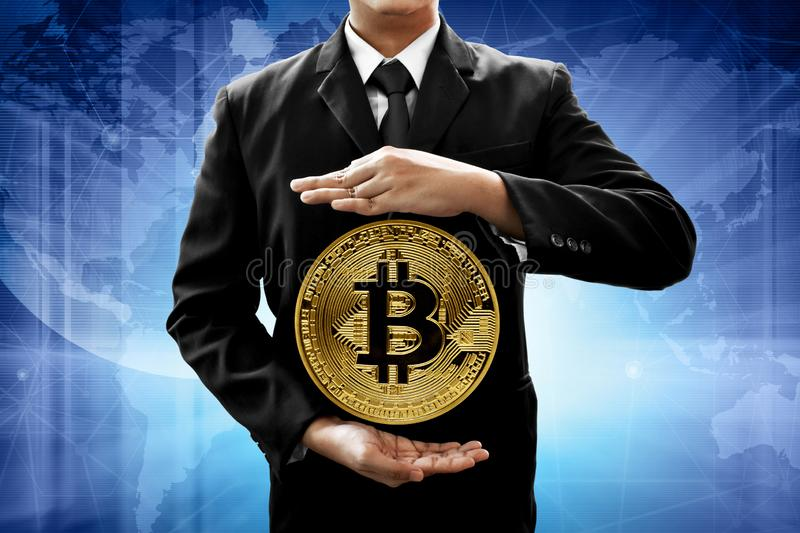 Businessman hold golden bitcoin coin. Businessman holding golden bitcoin coin stock photos