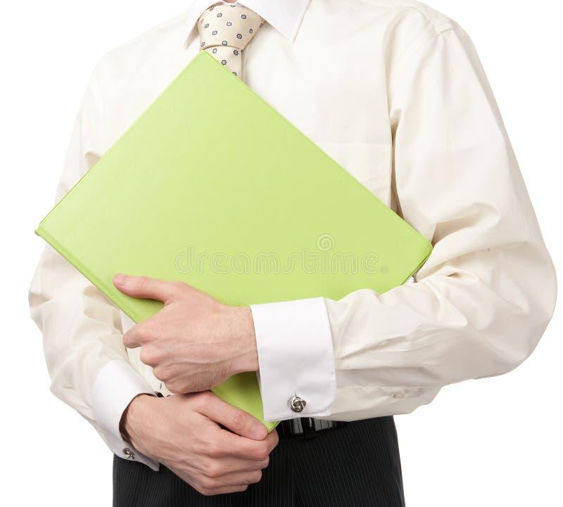 Download Businessman Holding Green Folder Stock Image - Image: 19192799