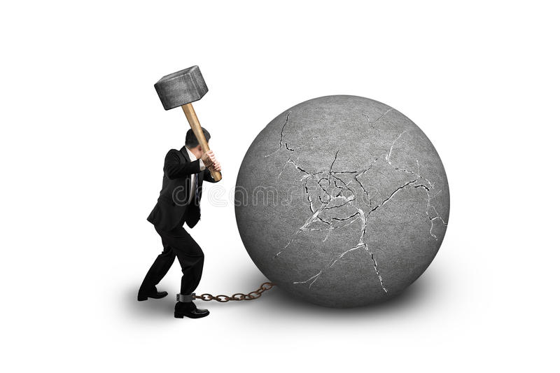 Businessman holding hammer hitting cracked concrete ball isolate royalty free stock images
