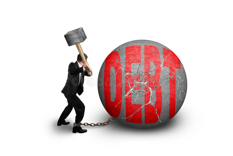 Businessman holding hammer hitting cracked DEBT ball isolated on. White background royalty free stock photo