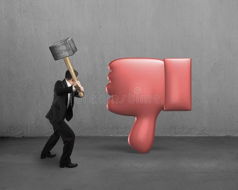 Businessman holding hammer hitting dislike thumb down. Mark royalty free stock image