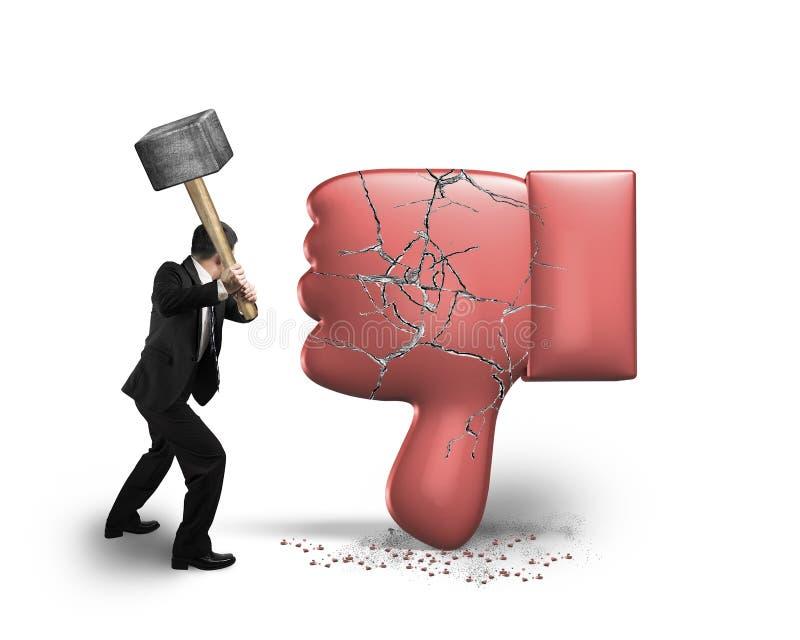 Businessman holding hammer hitting dislike thumb down mark with. Cracks, isolated on white background royalty free stock image