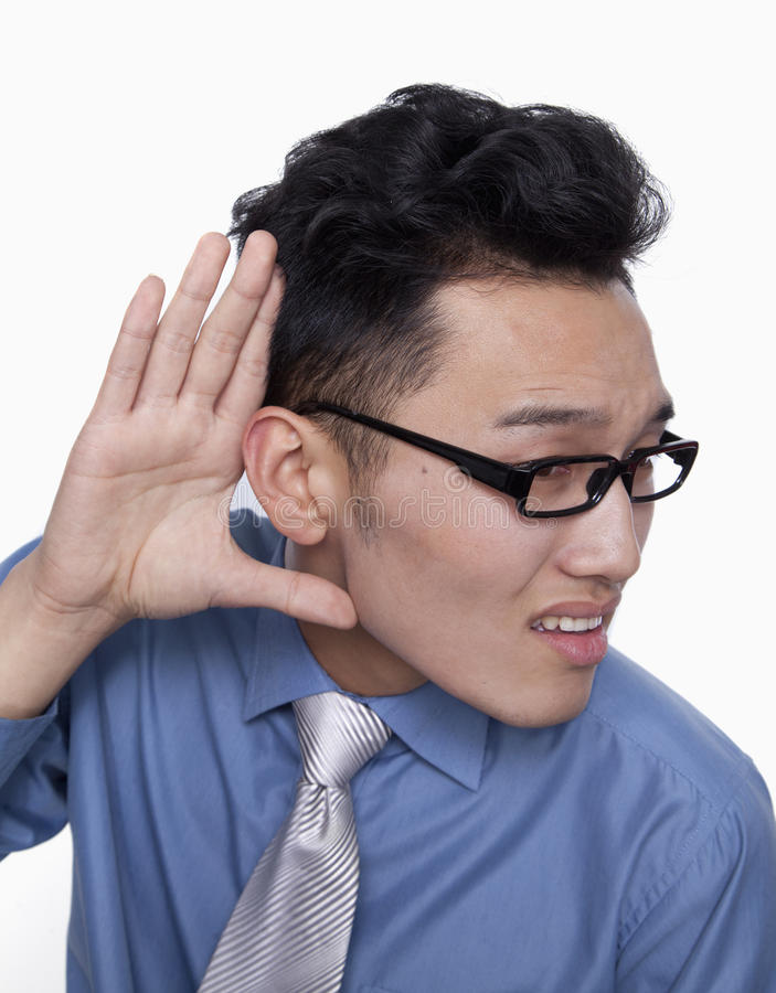 Businessman Holding Hand Up to Ear stock photo