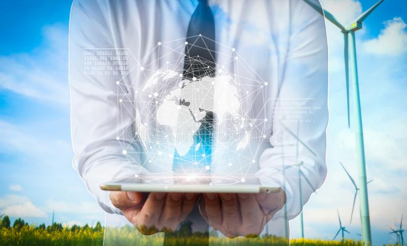 Businessman holding in hands tablet with global connection concept. royalty free stock image