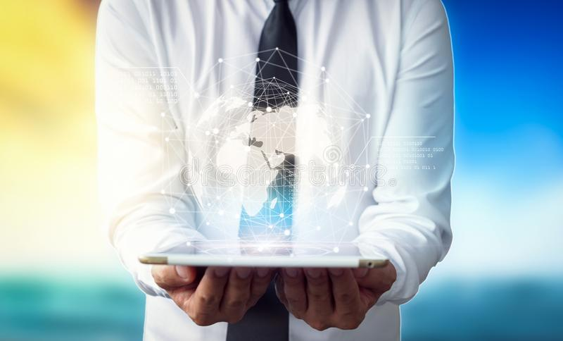 Businessman holding in hands tablet with global connection concept. stock photography