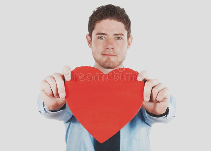 Businessman holding a heart shape royalty free stock photos