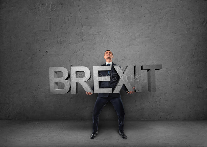 Businessman holding heavy 3d 'brexit' word in his hands. Businessman holding heavy 3d 'brexit' word in hisds. British withdrawal. Significant decision stock images