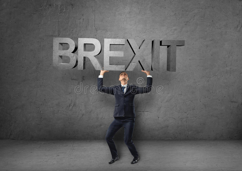 Businessman holding heavy 3d 'brexit' word over his head. British withdrawal. Significant decision. Substantial choice. Europe and United Kingdom. Difficulties stock photos