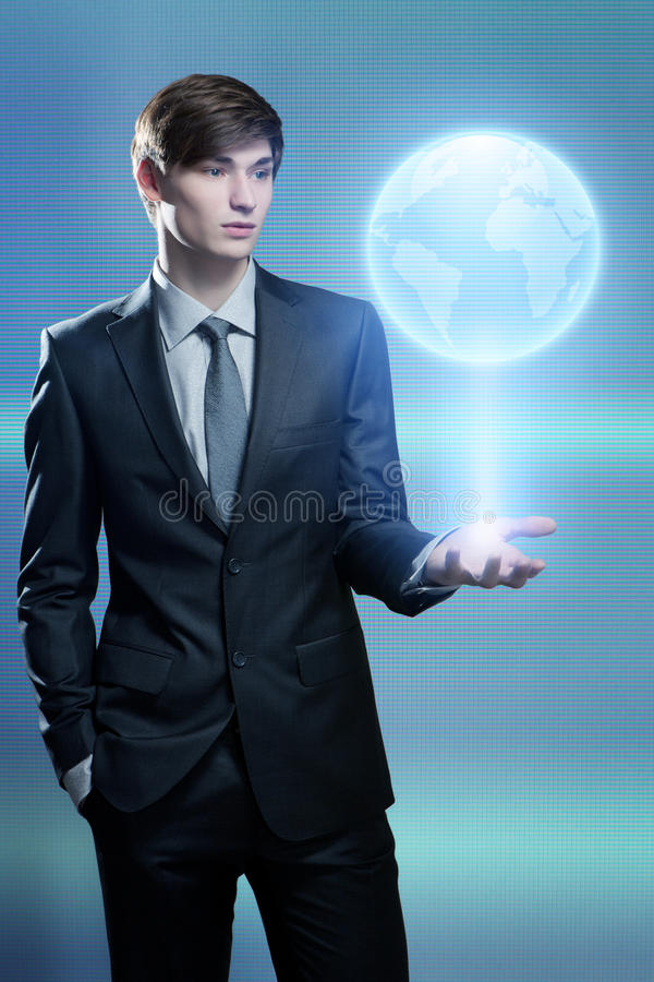 Businessman holding hologram of the earth stock images