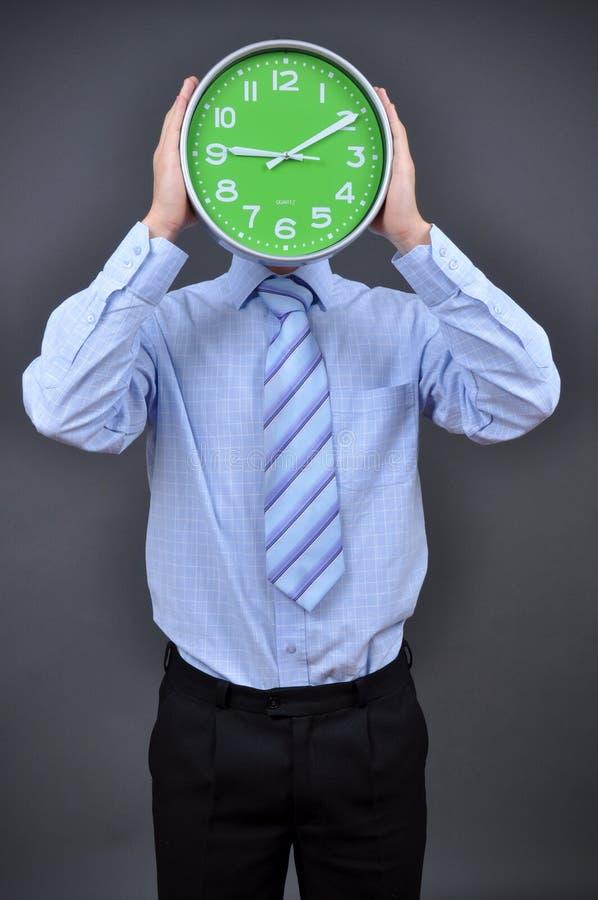 Businessman holding a hour stock photos