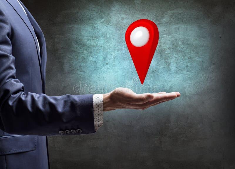 Businessman holding indicating location icon. royalty free stock photo
