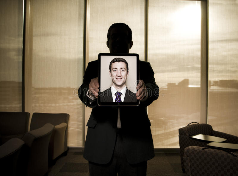 Businessman holding ipad tablet stock images