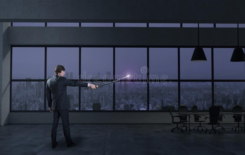 Businessman and japanese sword in the office stock photography