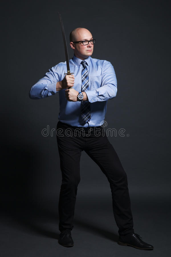 Businessman holding katana sword royalty free stock images